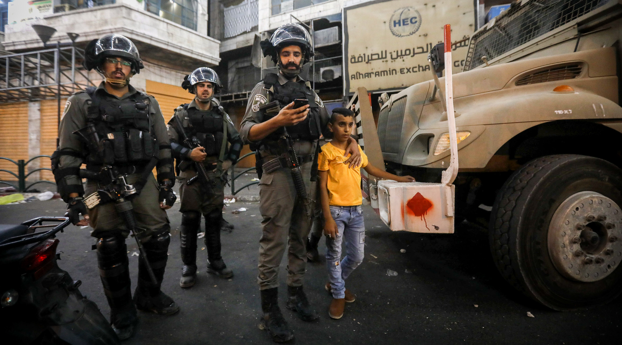 Israeli border police officers arrest a Palestinian youth during clashes with Palestinian protesters in the West Bank city of Hebron, Aug. 11, 2019. Rashida Tlaib and Ilhan Omar were scheduled to visit Hebron and other parts of the West Bank. (Wisam Hashlamoun/Flash90)