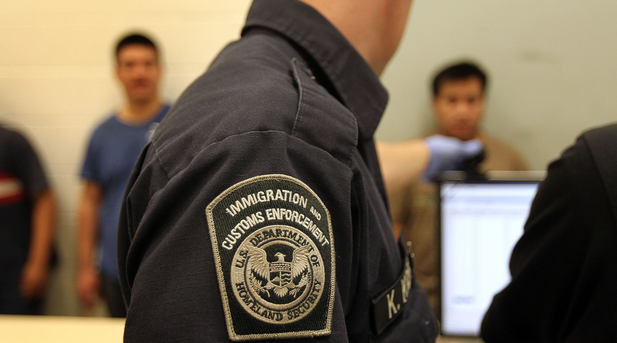 Undocumented Mexican immigrants are photographed while being in-processed at the Immigration and Customs Enforcement (ICE), center in Phoenix, Arizona, April 28, 2010. (John Moore/Getty Images)