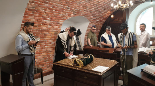 Rabbi Shimshon Izakson, second from left, praying with congregants at the Wooden Synagogue in Chisinau, Moldova on Aug. 26, 2019. (Cnaan Liphshiz)