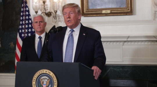 President Donald Trump makes remarks about the mass shootings in El Paso, Tex., and Dayton, Ohio, in the Diplomatic Reception Room of the White House as Vice President Mike Pence, Aug. 5, 2019. (Alex Wong/Getty Images)