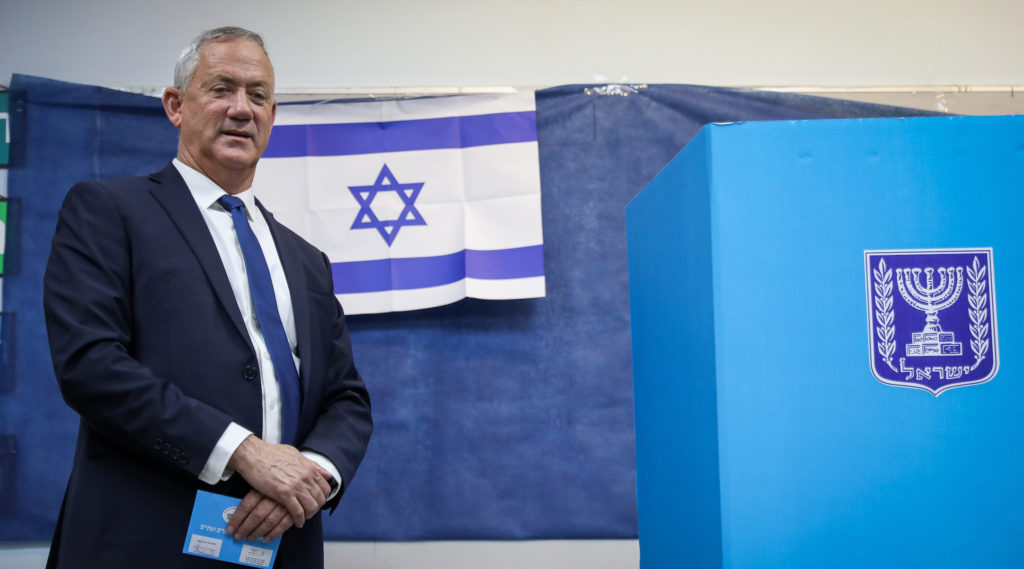 Netanyahu and Gantz too close to call, exit polls in Israel show