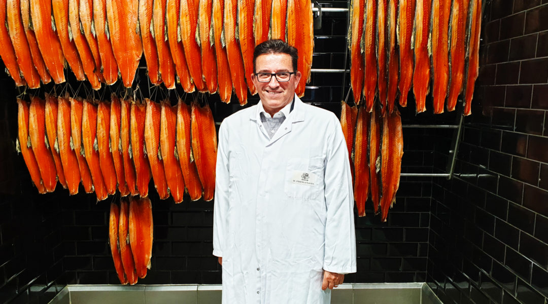 Lance Forman showing off the final product of his smoked salmon factory in the East End of London, the United Kingdom on Sept. 4, 2019 (Cnaan Liphshiz)