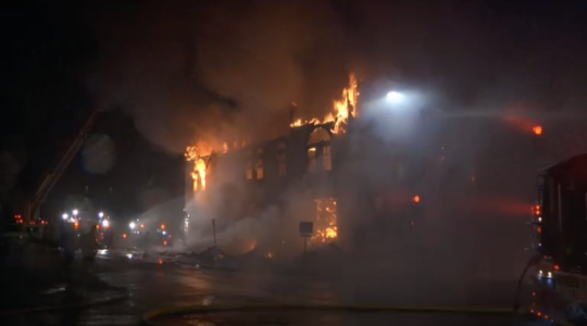 Adas Israel Congregation went up in flames early Monday morning. The cause of the fire is unclear. (Screenshot from KBJR Channel 6)
