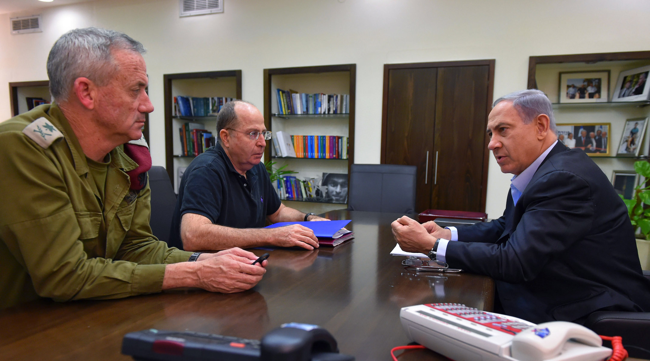 Nentanyahu, Defense Minister Moshe Yaalon and Gen. Benny Gantz (left) meet during the 2014 Gaza War. Gantz and Yaalon are now running against Netanyahu in the Israeli election, but they may all be forced to share power once it's over. (Ariel Harmoni/Getty Images)
