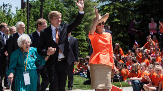 Berendina Eman, left, walking with Dutch King Willem-Alexander and Queen Máxima in Grand Rapids, Michigan on June 2, 2015. (Courtesy of the Dutch Embassy in the United States)