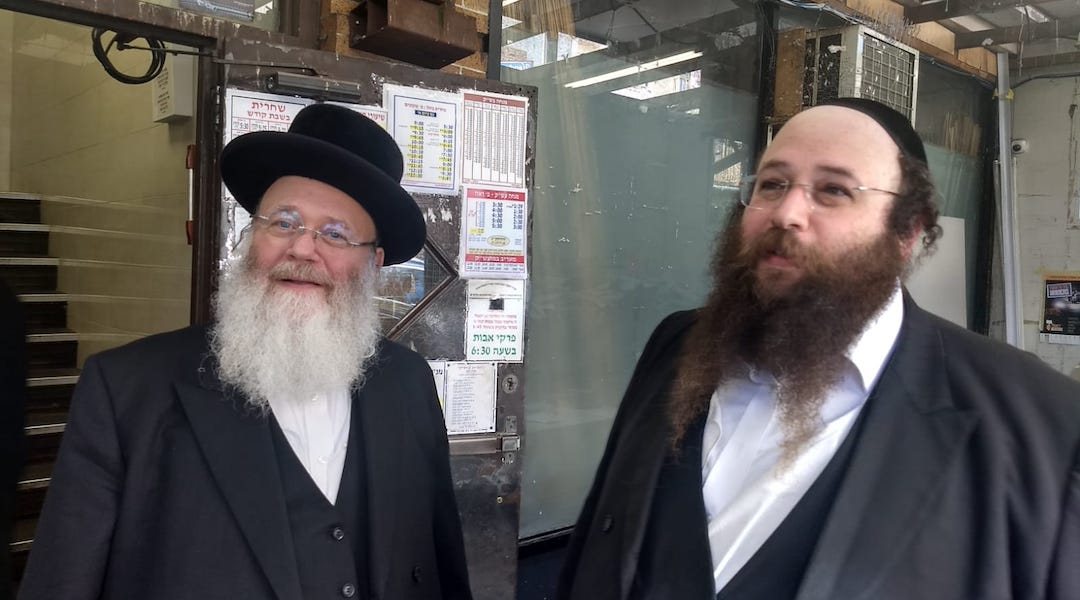 Yosef Rapaport, left, and his son Alex do not feel that life has become more dangerous for Orthodox Jews in Brooklyn. They say attacks on Jews are nothing new. (Ben Sales)