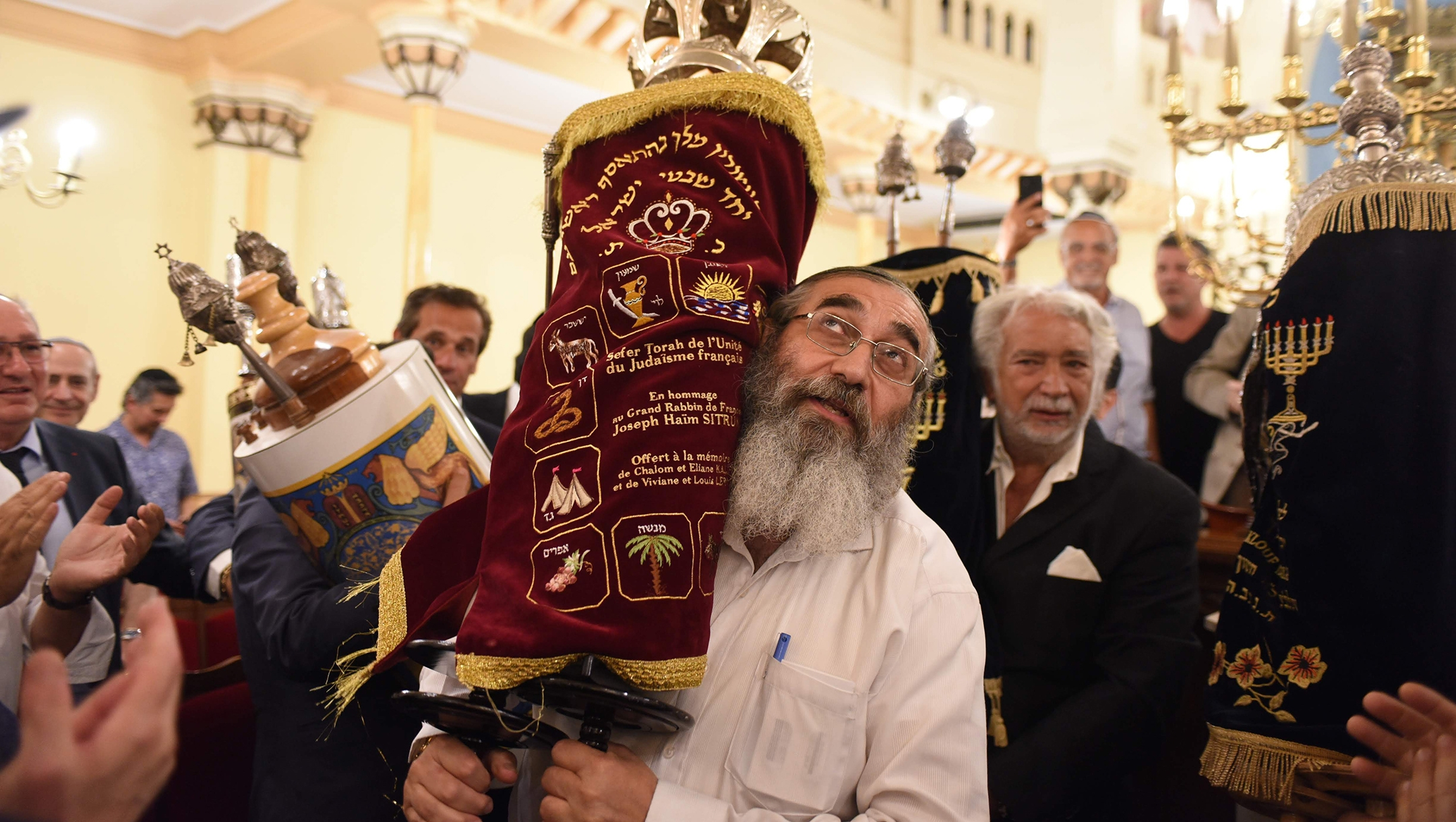 French Jews celebrating the inauguration of a new Torah scroll at the Grand Synagogue of Nice on July 11, 2019. (Courtesy of Consistoire Nice/Henri Belhassen)