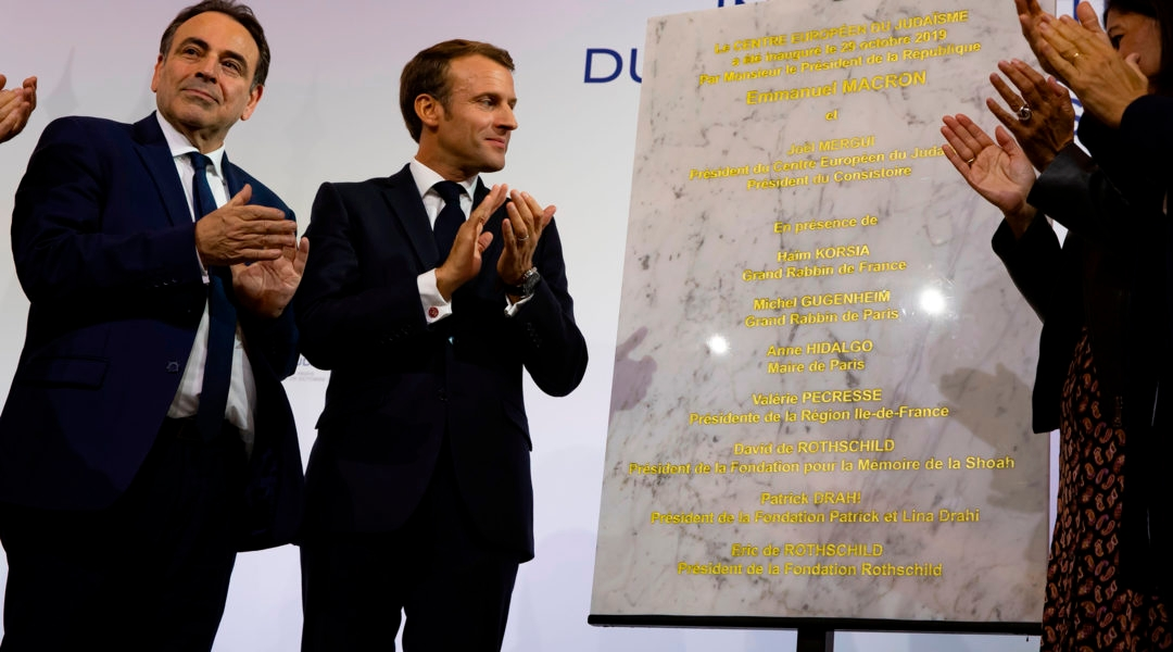 Consistoire President Joel Mergui, left, and French President Emmanuel Macron celebrating the inauguration in Paris, France of a new Jewish community center on Oct. 29, 2019.
