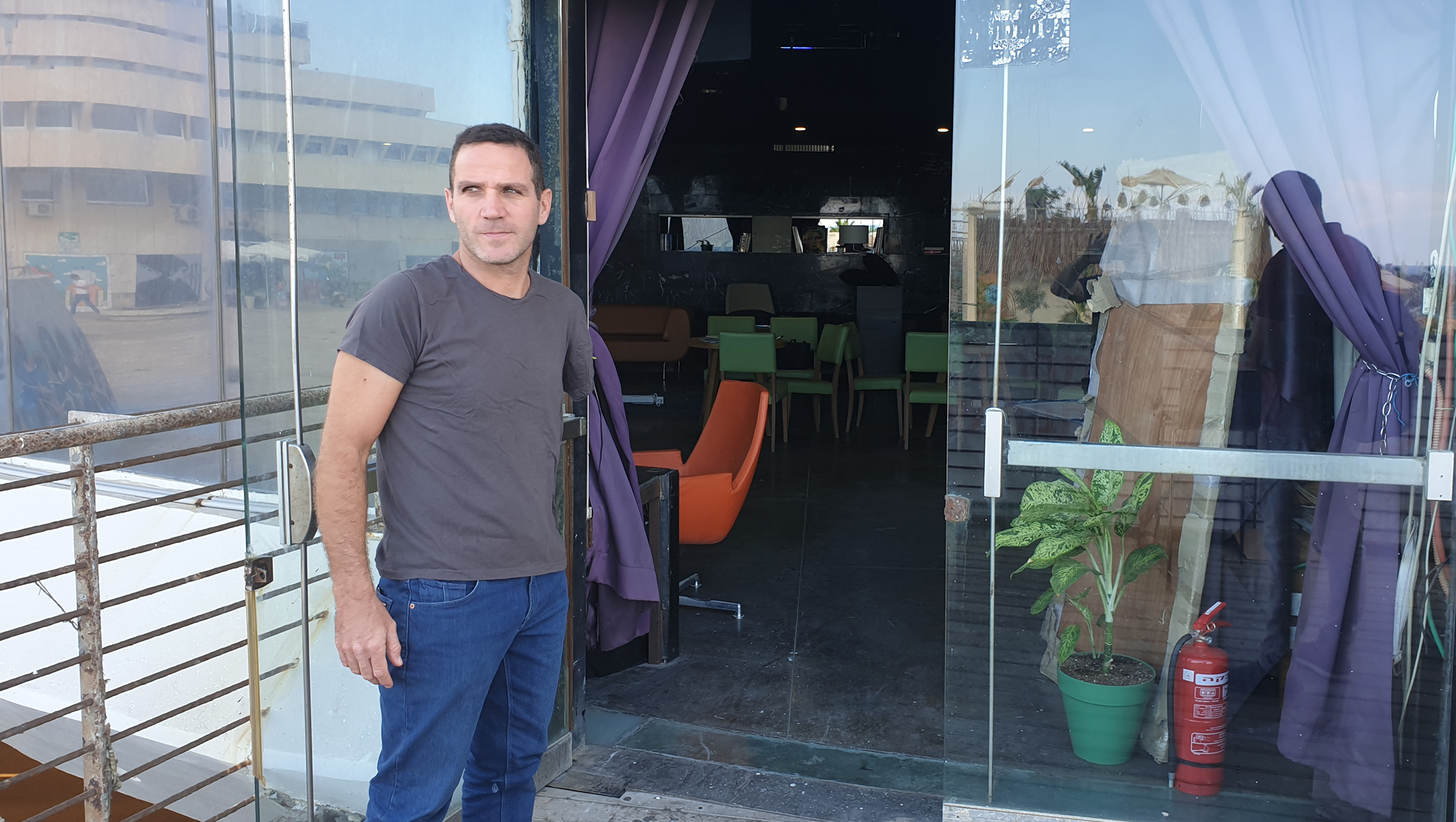 Social activist Yakir Segev standing outside what used to be the Pussycat strip club in Tel Aviv, Israel on Oct. 7, 2019. (Cnaan Liphshiz/JTA)