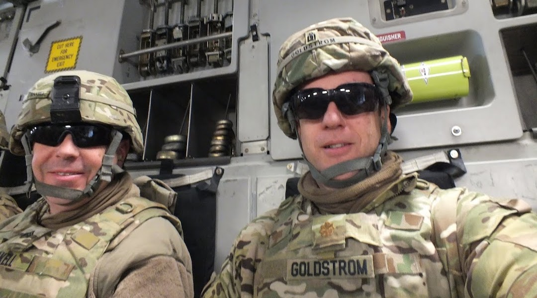 Goldstrom (right) with his chaplain assistant in Afghanistan, Sgt Teakull, while riding to visit military personnel at other bases and outposts in 2013. (Courtesy of Goldstrom)