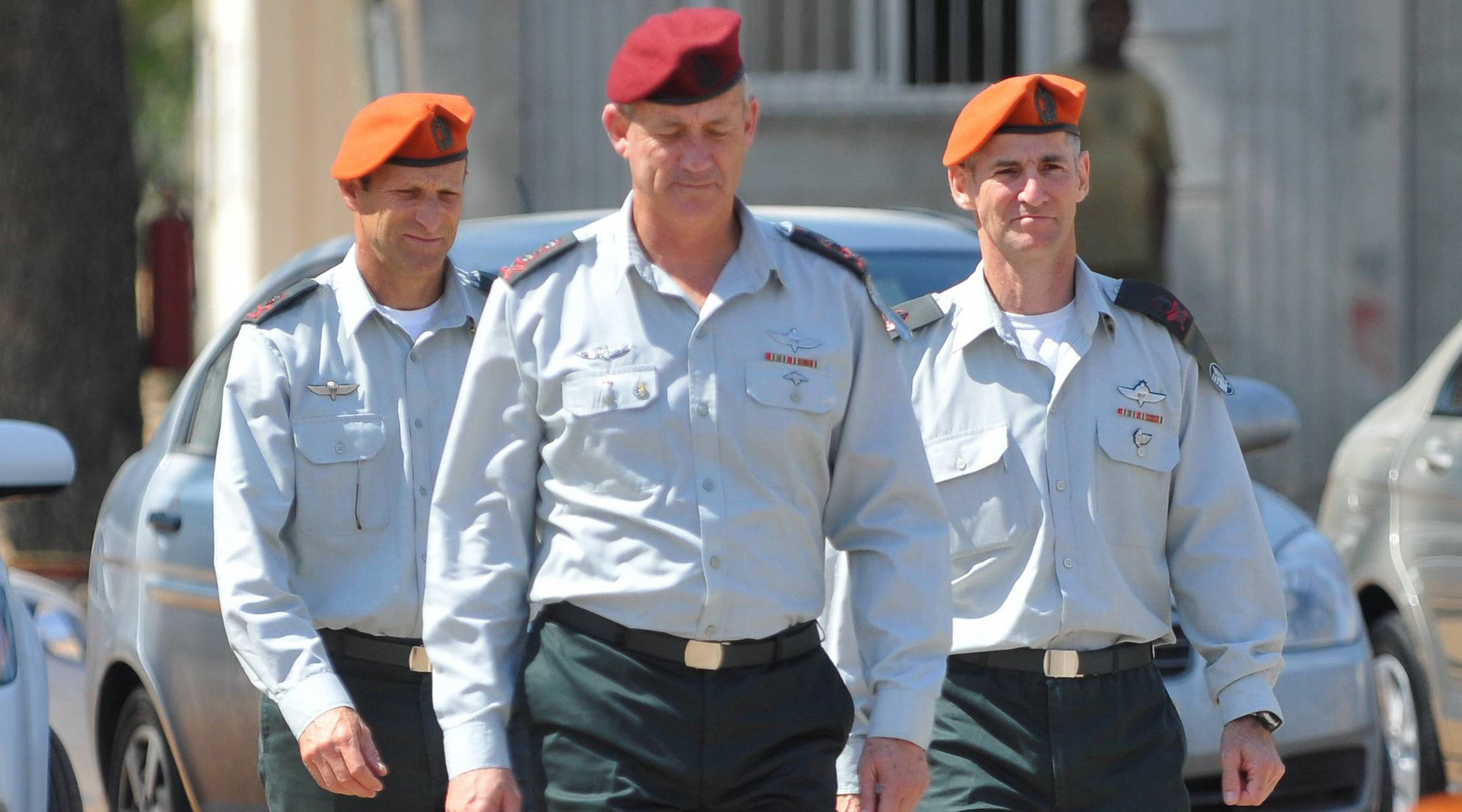 Chief-of-Staff Benny Gantz walks in front of the outgoing head of the Home Front Command, Yair Golan (right), and incoming Brigadier-General Eyal Eisenberg on June 15, 2011. (Yossi Zeliger/Flash90)