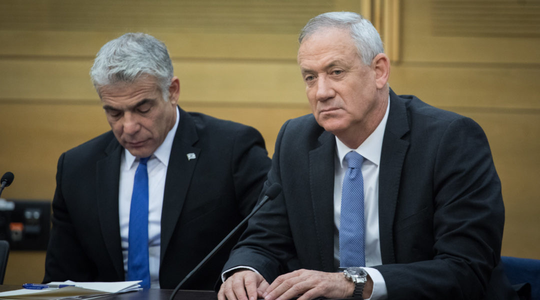 Blue and White party chairmen Benny Gantz and Yair Lapid during a faction meeting at the Knesset, the Israeli parliament in Jerusalem, Nov. 18, 2019. (Hadas Parush/Flash90)