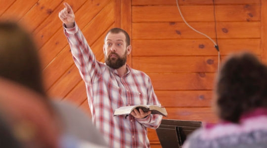 Pastor Aaron Dudley leads a service at the Machias Christian Fellowship church in Machias, Maine on Sunday, February 19, 2017. (Gregory Rec/Getty Images)