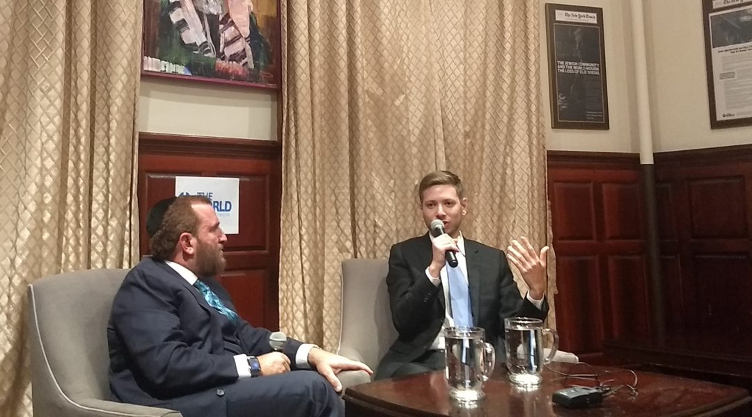 Yair Netanyahu, Israeli Prime Minister Benjamin Netanyahu's son, speaks with Rabbi Shmuley Boteach on Nov. 6, 2019 in New York City. (Ben Sales)
