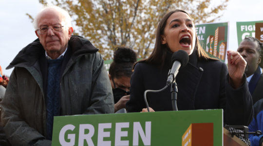 Democratic presidential candidate Sen. Bernie Sanders and Rep. Alexandria Ocasio-Cortez holding a news conference in Washington, DC on November 14, 2019. (Chip Somodevilla/Getty Images)