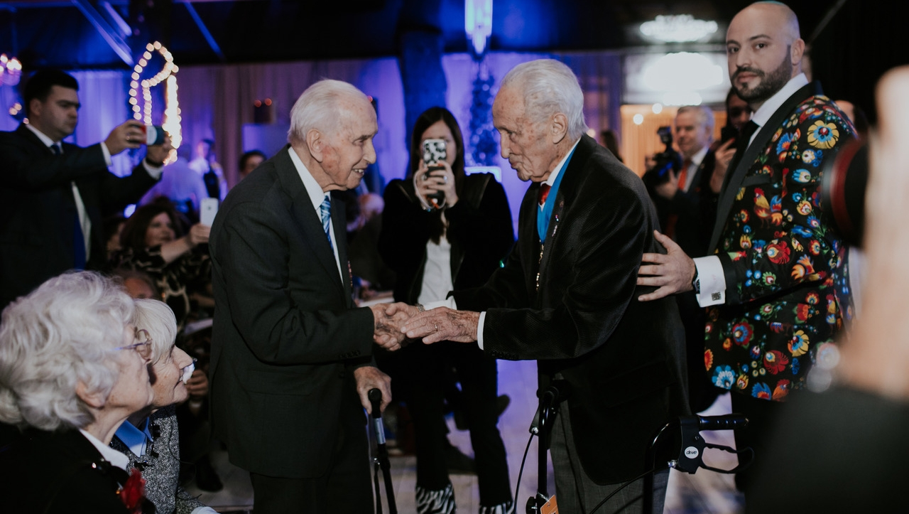 Edward Mosberg, center, and Jonny Daniels, right, celebrating with Jozef Walaszczyk his centenary birthday party in Warsaw, Poland on Nov. 14, 2019. (From the Depths)