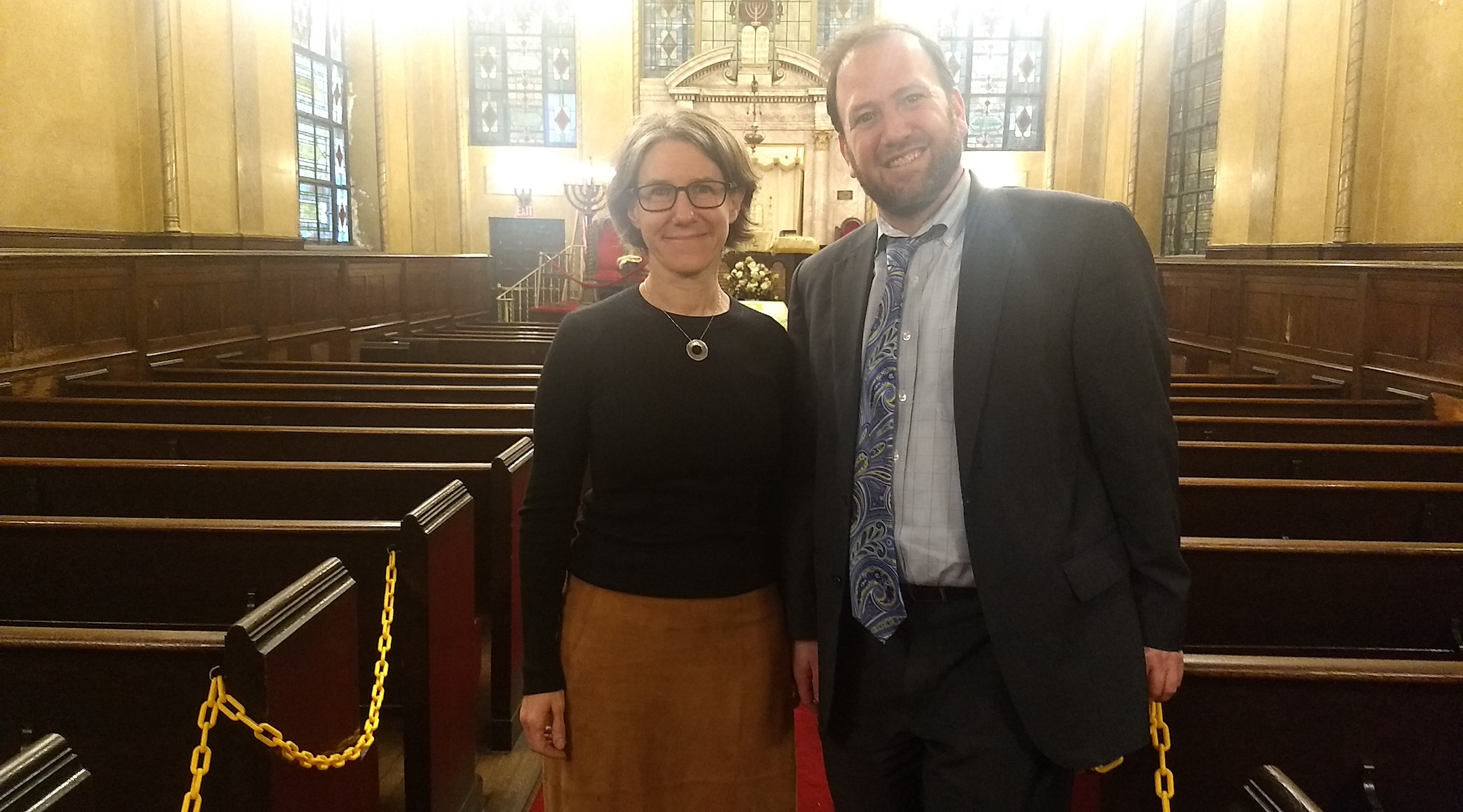 Rabbi Jason Herman and architect Esther Sperber stand in the sanctuary of the West Side Jewish Center. (Ben Sales)