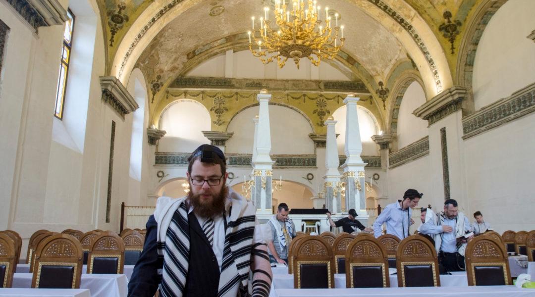 Rabbi shlomo Koves, left, praying at his Obuda Synagogue in Budapest, Hungary on Oct. 7, 2019. (Courtesy of EMIH)