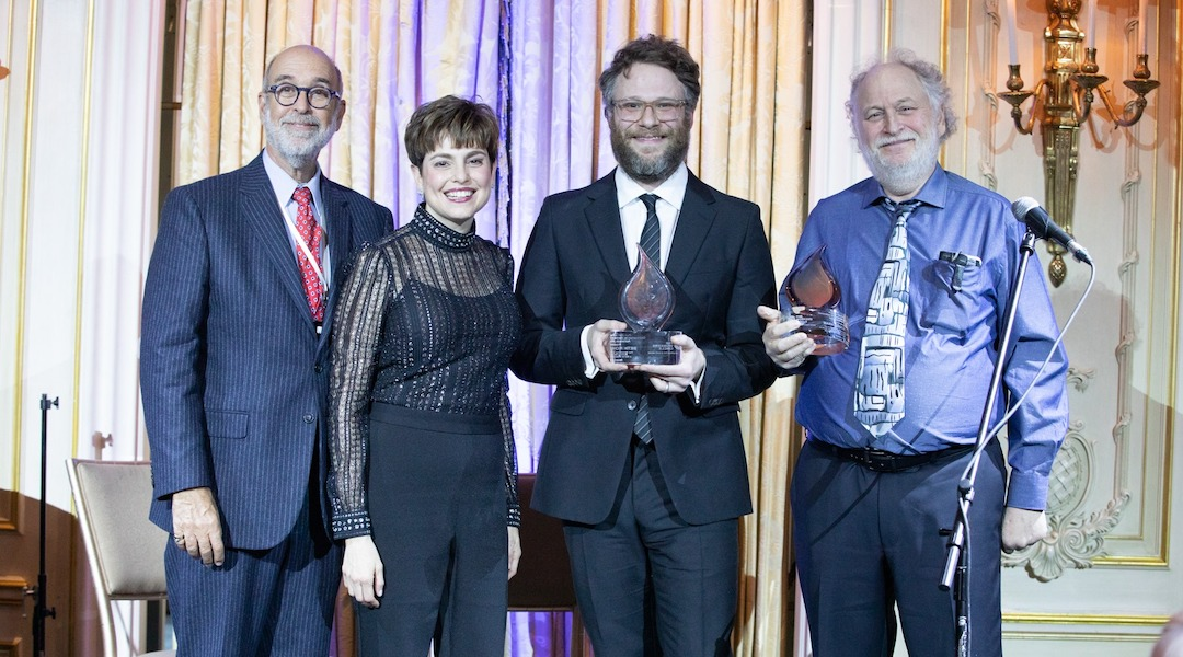 From left: Rich Rumelt, the board president of The Workers Circle; Ann Toback, the group's executive director; Seth Rogen; and Mark Rogen at the organization's ceremony in New York City, Dec. 2, 2019. (Mark Stephen Kornbluth)