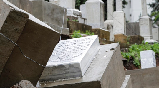 Damaged graves following a winter storm at the Jewish cemetery in Beirut. (Anwar Amro/Getty Images)