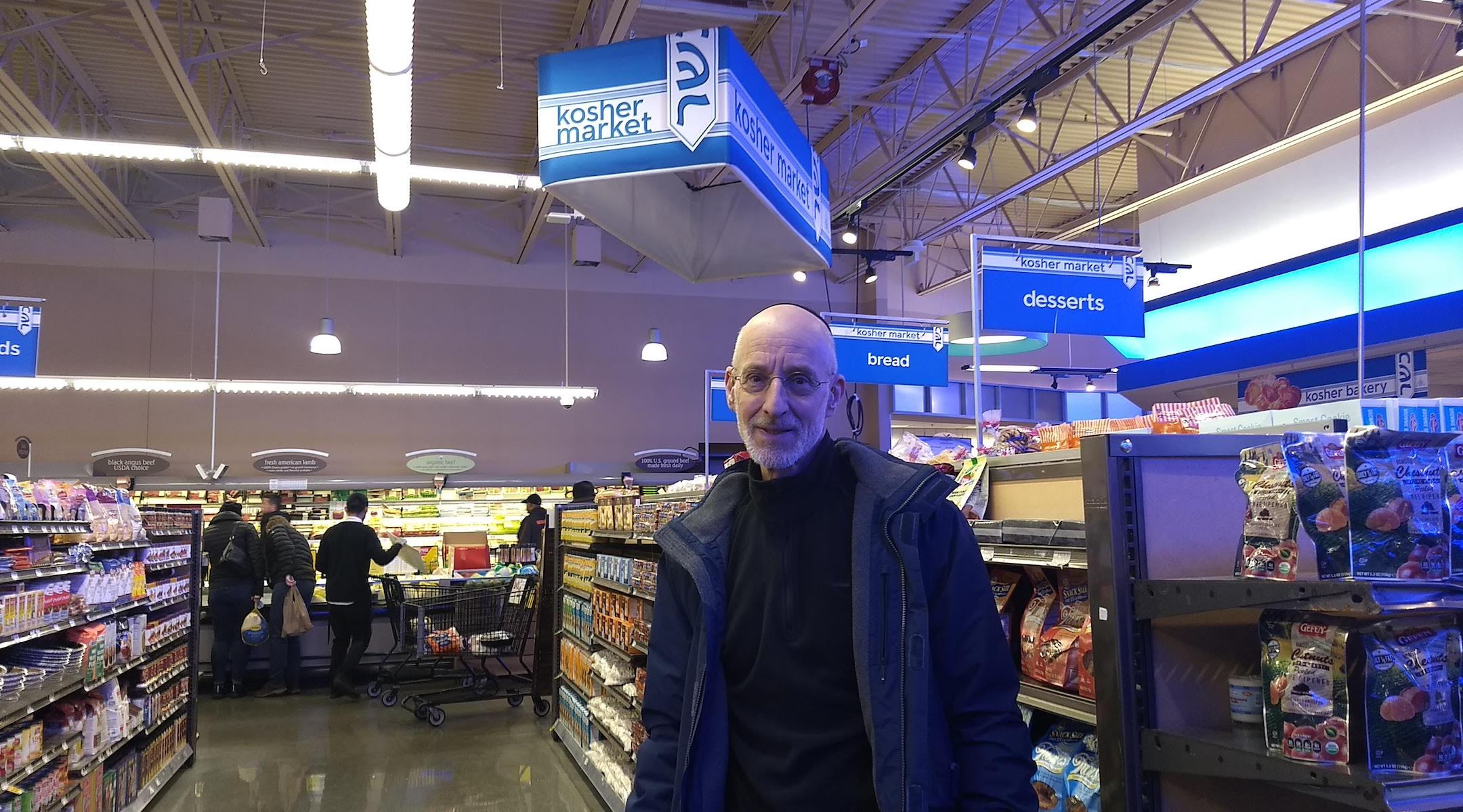 Howard Rieger, a former CEO of the Jewish Federations of North America, stands in a new kosher section in a West Rogers Park grocery store. (Ben Sales)