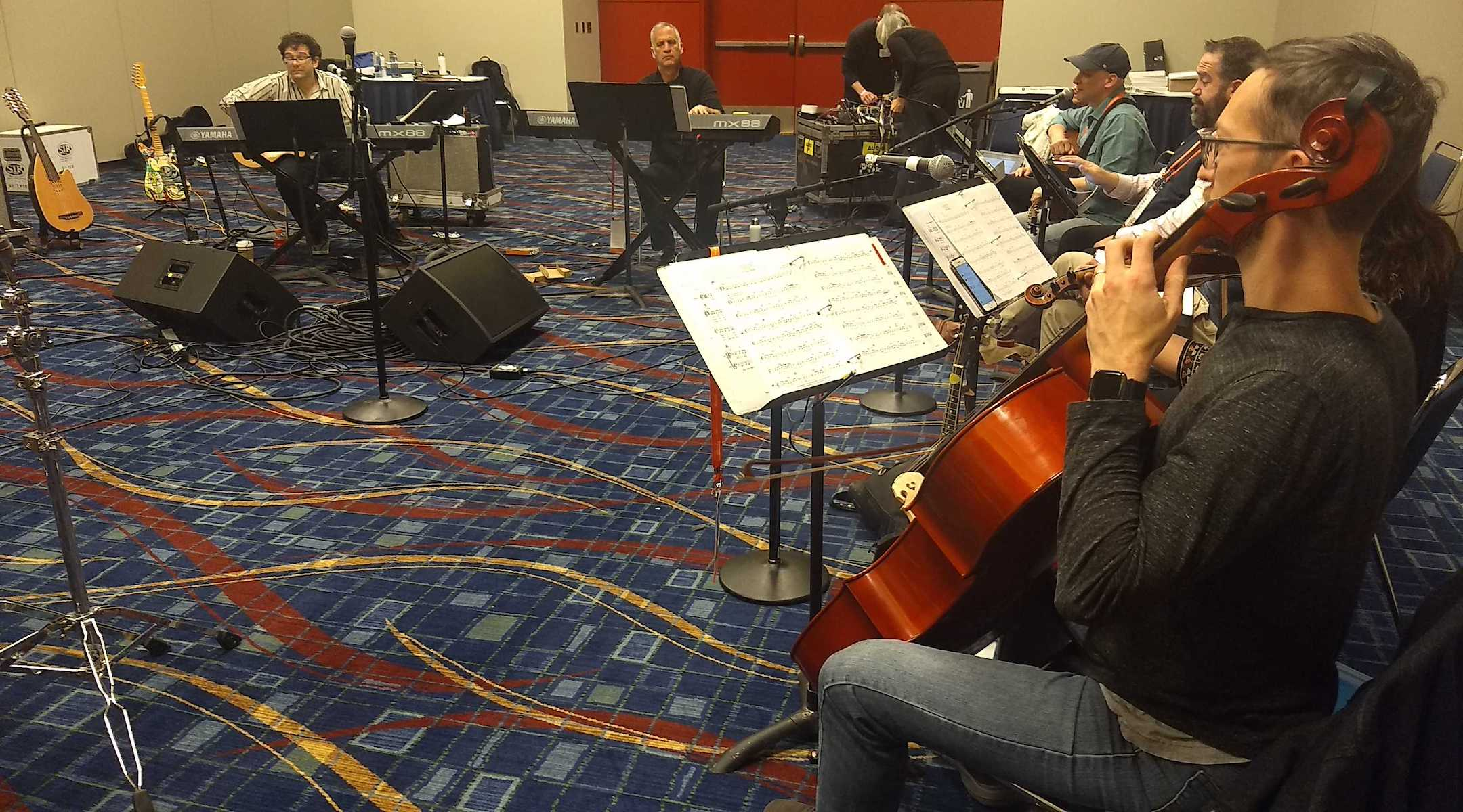 Members of the Reform Biennial Friday night service band practice on Thursday, Dec. 12 in Chicago. Josh Nelson, the biennial's artistic director, is at left. (Ben Sales)