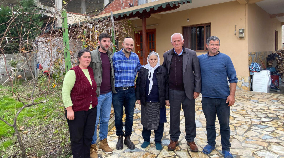 Jonny Daniels, third from left, with the Bicaku family in their home in Durres, Albania on Dec. 11, 2019. (Courtesy of From the Depths)