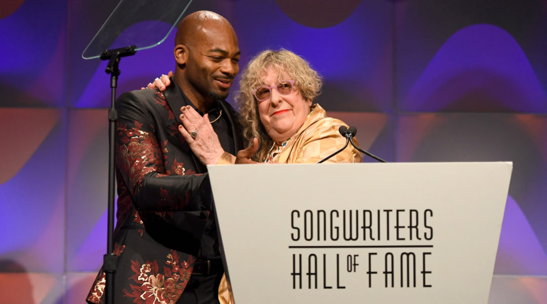 Allee Willis receiving an award from Brandon Victor Dixon during the Songwriters Hall of Fame 49th Annual Induction in New York, the United States on June 14, 2018. (Larry Busacca/Getty Images for Songwriters Hall Of Fame)