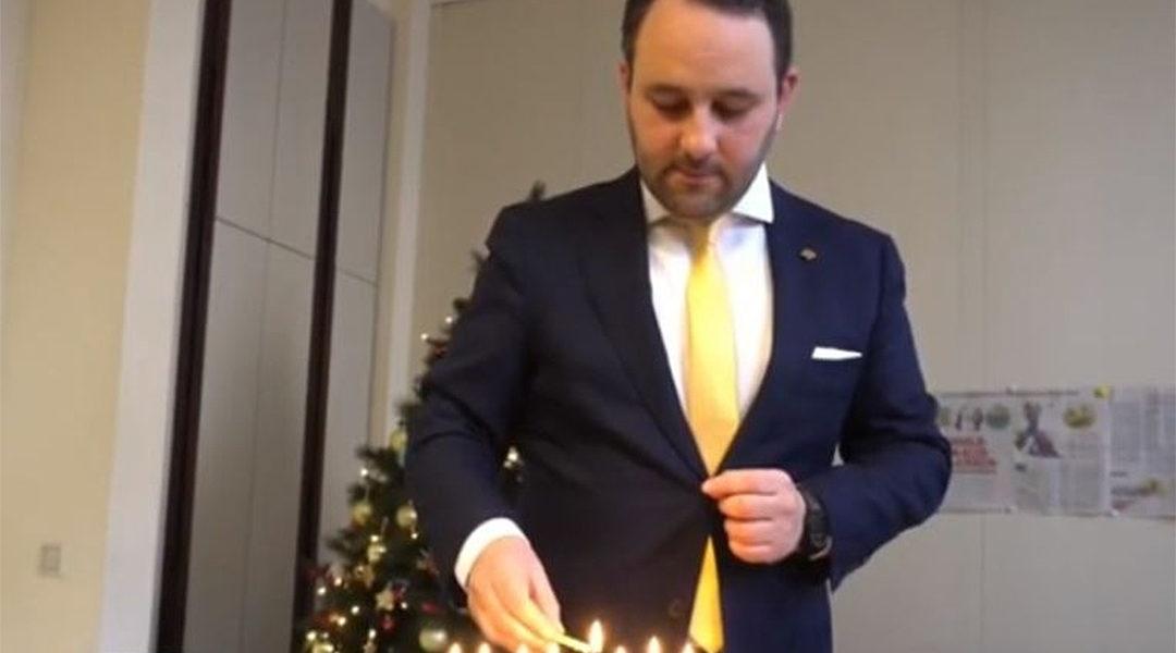 Michael Freilich lighting Hanukkah candles in the Belgian federal parliament in Brussels, Belgium on Dec. 19, 2019. (Michael Freilich)