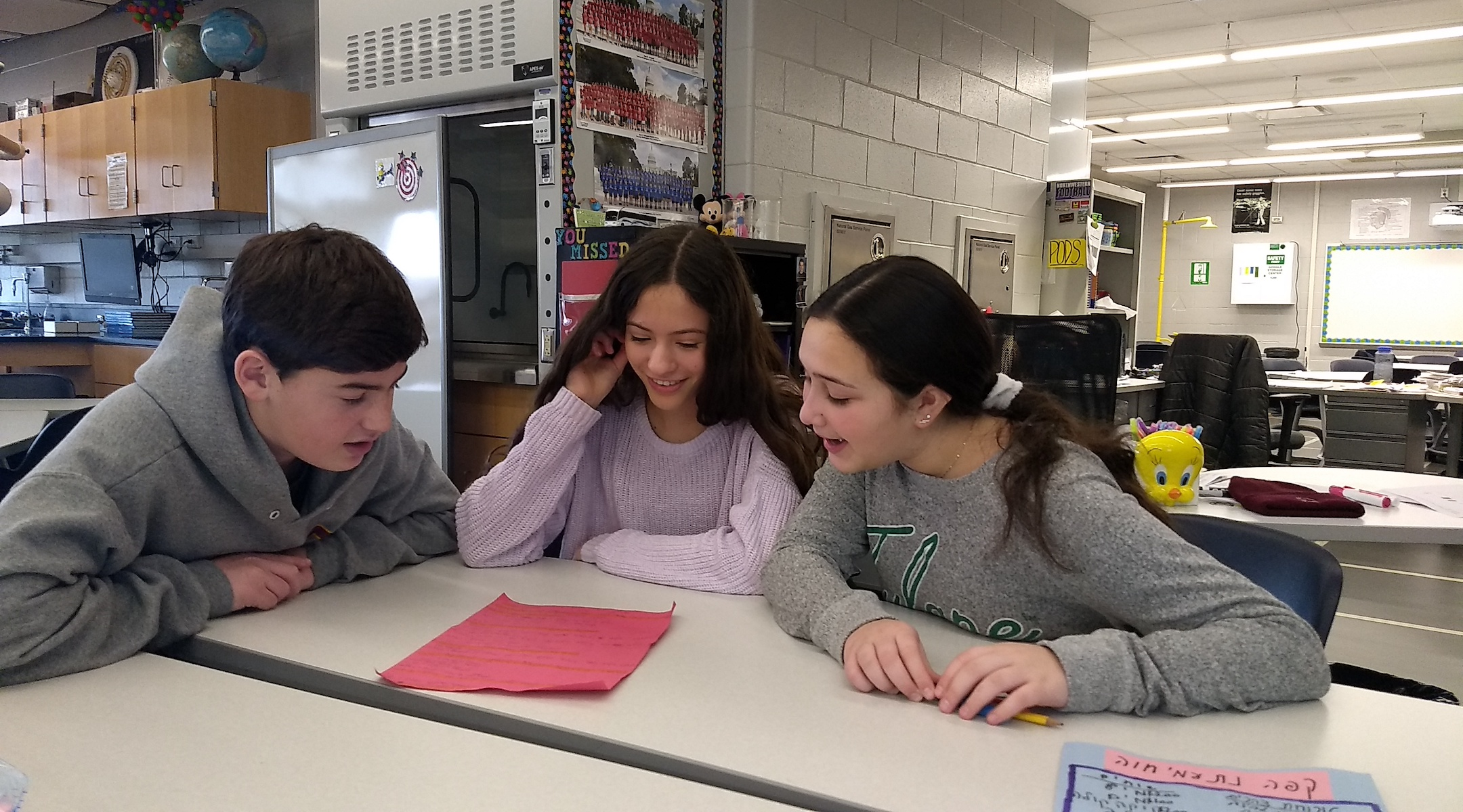 Students in an 8th grade Hebrew class at Alan B. Shepard Middle School in Deerfield, Ill. write a Hebrew screenplay together on Dec. 13. (Ben Sales)