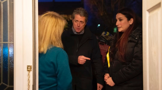 Hugh Grant, left, canvassing in Finchley, London, with Liberal Democratic parliament candidate Luciana Berger, right, Dec. 1, 2019. (David Mirzoeff/PA Images via Getty Images)