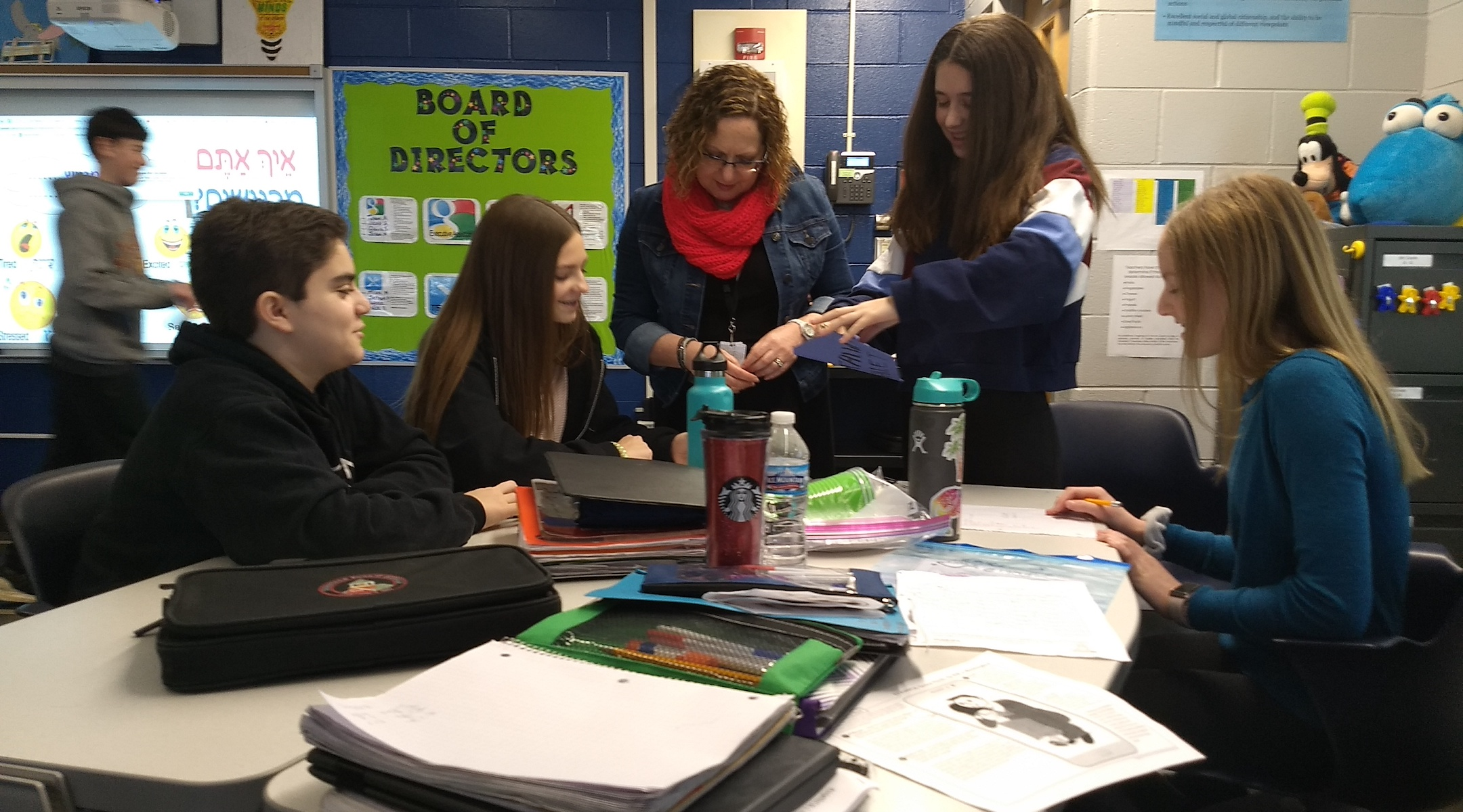 Teacher Osnat Lichtfeneld (center) guides students in an 8th grade Hebrew class at Alan B. Shepard Middle School in Deerfield, Ill. on Dec. 13. (Ben Sales)