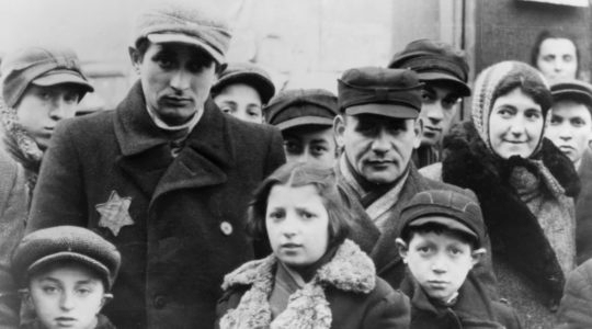 Jews wearing Star of David badges in the Lodz Ghetto in Poland. (Jewish Chronicle/Heritage Images/Getty Images)
