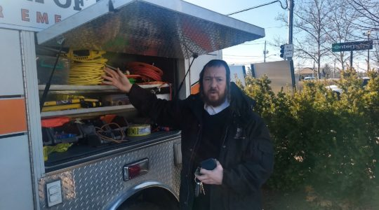 Josef Margaretten, the coordinator of Chaverim of Rockland, displays some of the emergency services agency's equipment. (Ben Sales)