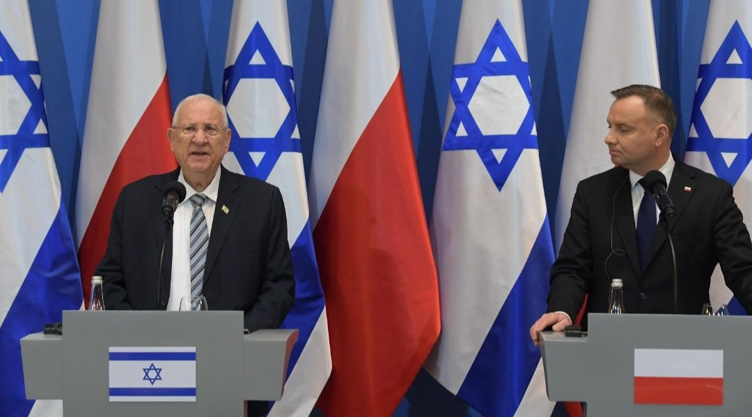 Israel's president says too many Poles helped murder Jews in the Holocaust and salutes rescuers
