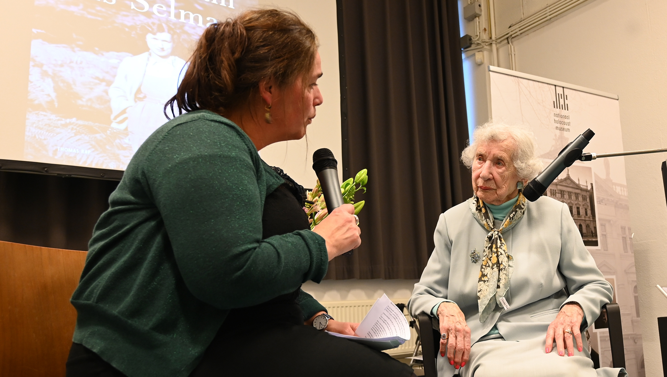 Selma van de Perre, right, being interviewed about her book at the National Holocaust Museum in Amsterdam, the Netherlands on Jan. 9, 2020. (Cnaan Liphshiz)