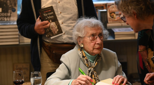 Selma van de Perre singing her book at the National Holocaust Museum in Amsterdam, the Netherlands on Jan. 9, 2020. (Cnaan Liphshiz)