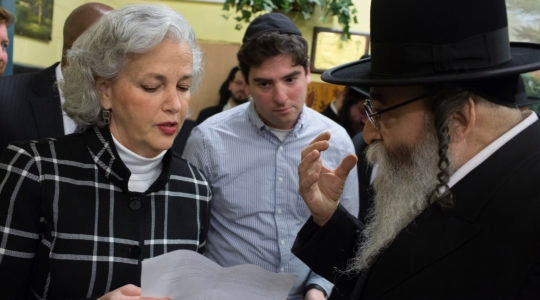 Deborah Lauter, the new director of the New York City Office for the Prevention of Hate Crimes, attends a press conference to denounce the hate crime attack in Jersey City in the Williamsburg neighborhood of Brooklyn, New York on December 12, 2019. (Andrew Lichtenstein/Getty Images)