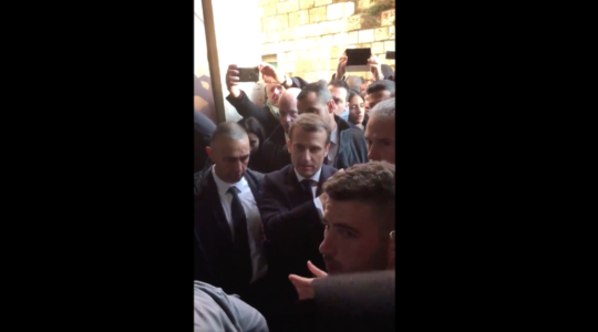 Emmanuel Macron yelled at police officers escorting him to a church in Jerusalem, Jan. 22, 2020. (Ava Djamshidi/Twitter)