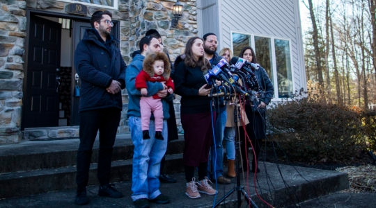 Nicky Cohen and David Neumann, children of the Dec. 28 Monsey stabbing attack victim Josef Neumann, speaking to the media at New City, New York on January 2, 2020. (Eduardo Munoz Alvarez/Getty Images)