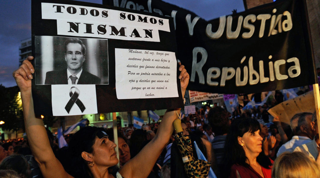 A woman holding a signs with prosecutor Alberto Nisman's portrait in Rosario, Argentina on Feb. 18, 2015. (STR/AFP via Getty Images)