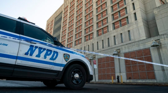 An NYPD vehicles sits outside the Metropolitan Detention Center in Brooklyn on February 4, 2019. (Drew Angerer/Getty Images)