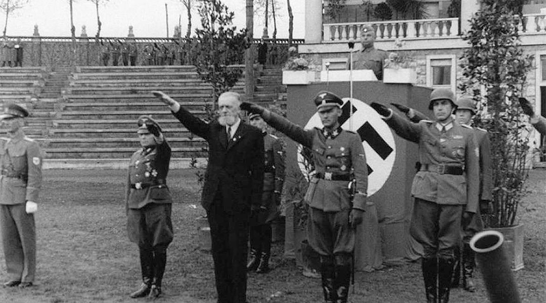 Leon Rupnik, wearing a suit, giving the Nazi salute with German soldiers in Slovenia sometime between 1943 and 1945. (Archives of the Republic of Slovenia)