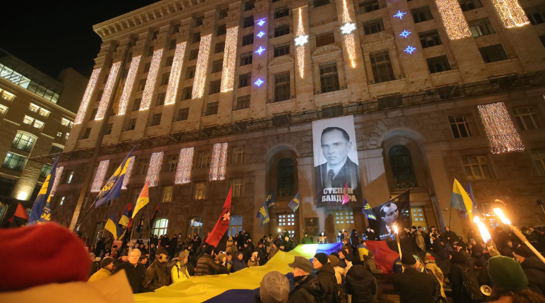 Marchers rally outside the Kyiv City State Administration during a torchlight procession honoring Stepan Bandera, in Kyiv, Ukraine on Jan. 1, 2020. (Pavlo_Bagmut/ Ukrinform / Barcroft Media via Getty Images)