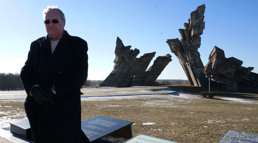 Nazi-hunter Efraim Zuroff saying Kadish, a mourning prayer, for Holocaust victims near Kaunas, Lithuania on Feb. 15, 2015. (Cnaan Liphshiz/JTA)