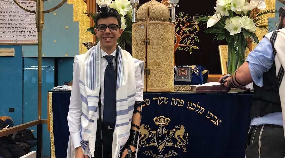 Ruben Golran, a Milanese bar mitzvah boy, upon putting on tefillin for the first time. (Courtesy of the Golran family)