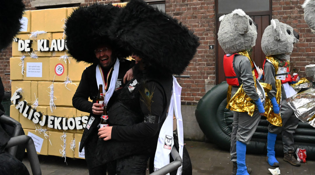 Men wearing a haredi Jews suit with an ant's abdomen and legs at the annual procession of the carnival in Aalst, Belgium on Feb. 23, 2020. (Cnaan Liphshiz)