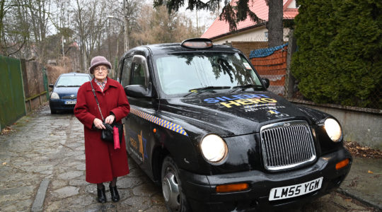 nnaStupnicka-Bando, the 90-year-old president of the Polish Association of the Righteous Among the Nations, entering one of the From the Depths taxis for saviors of Jews in Warsaw, Poland on Jan. 29, 2020. (Cnaan Liphshiz)
