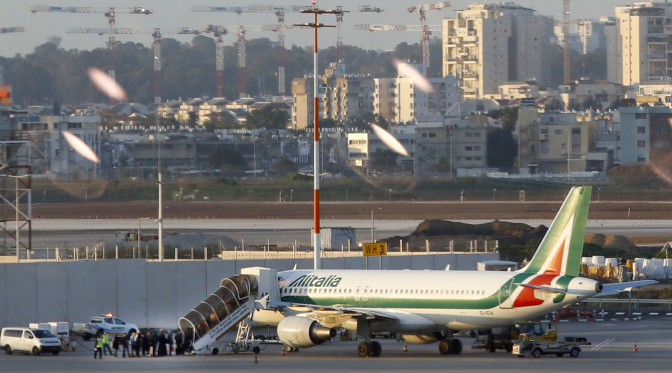 Travelers from Italy board an Alitalia plane after they were denied entry to Israel at Ben Gurion International Airport near Tel Aviv on February 27, 2020. (Jack Guez/AFP via Getty Images)
