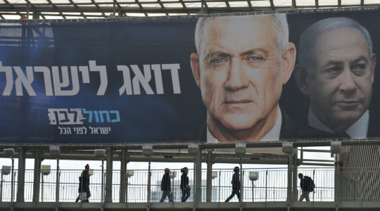 A campaign billboard in Ramat Gan, a suburb of Tel Aviv, featuring Blue and White party leader Benny Gantz in front of Israeli Prime Minister Benjamin Netanyahu. (Artur Widak/Getty Images)